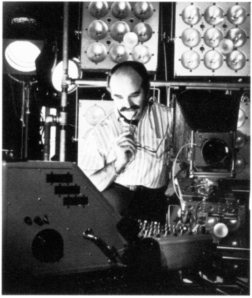Lionel Freedman with strob equipmente units and a mobile lighting console that he designed and built for the studio, circa 1960s.